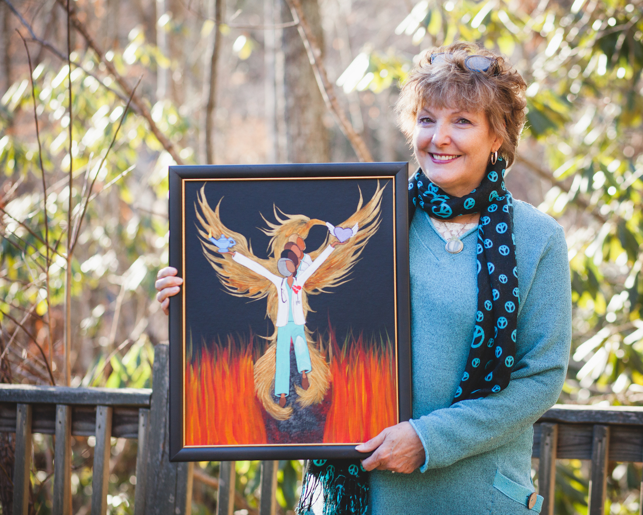 "Karen holding a painting of the ""Phoenix Nurses"""